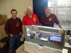 The Exhibition Committee making an exhibition of themselves at the Narrow Gauge show in Shepton Mallet in February 2015.